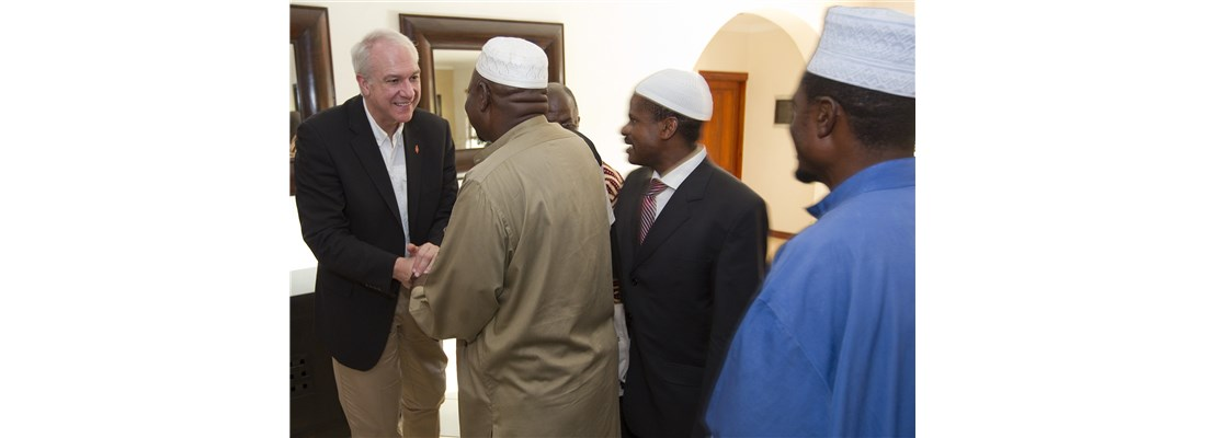 United Methodist Bishop Thomas Bickerton of Pittsburgh greets officials in Democratic Republic of Congo.