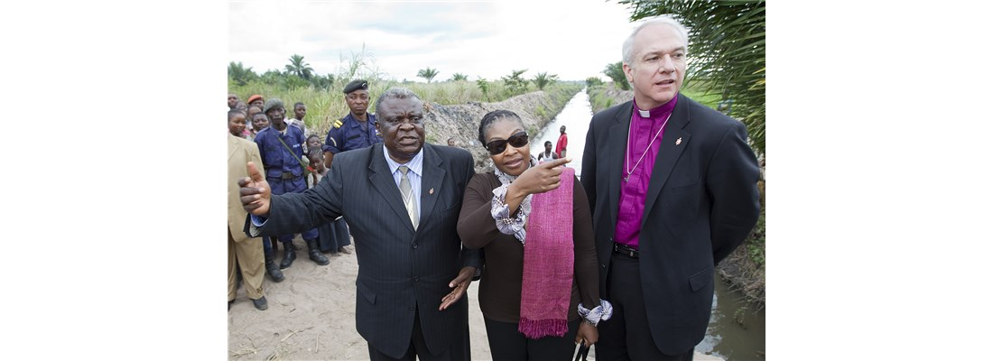 Bishop Ntambo Nkulu of North Katanga shows celebrity Yvonne Chaka Chaka and Bishop Thomas Bickerton a canal project to remove standing water where mosquitoes breed. Photo by Mike DuBose
