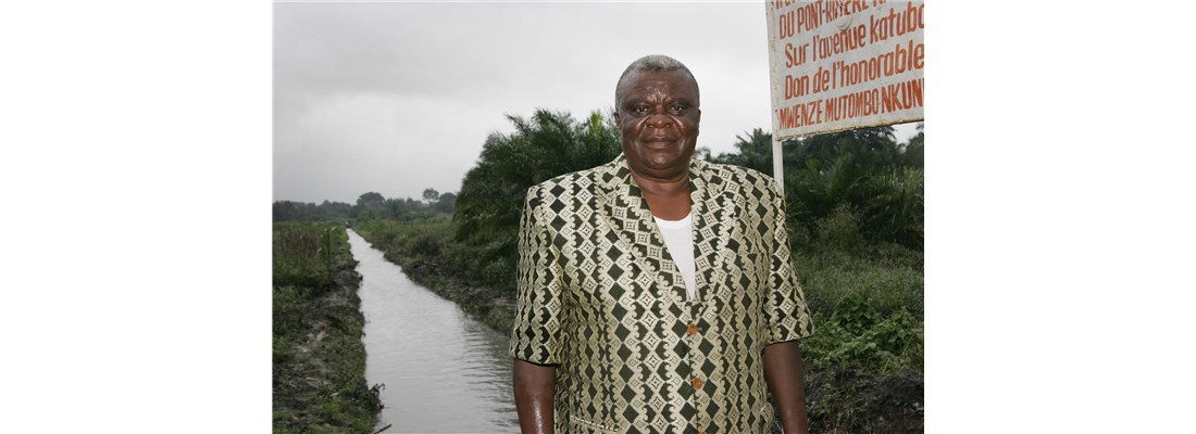 Bishop Ntambo Nkulu Ntanda of North Katanga Annual Conference stands near one of series of canals he encouraged residents to dig around the city of Kamina to eliminate standing water where mosquitos breed.