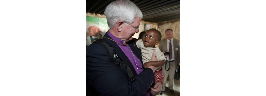 Bishop James Dorff meets Dunongo after her family received an insecticide-treated bed net to protect from mosquitos carrying malaria in Congo.